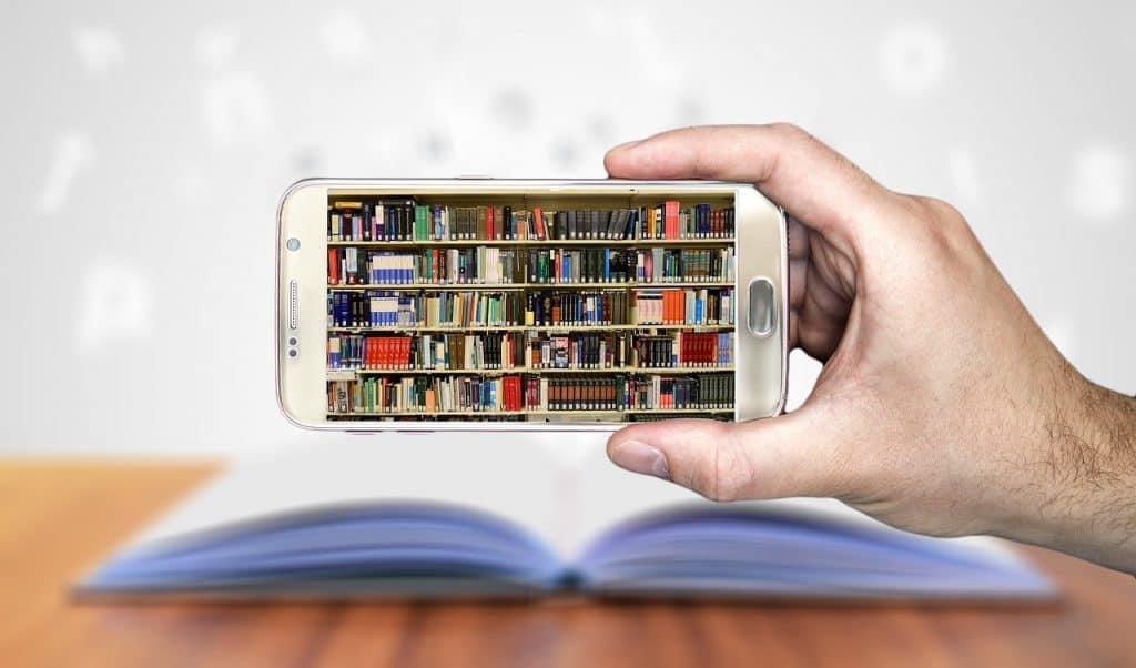 books, smartphone, hand